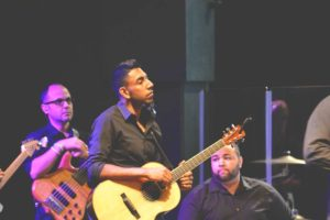 Jobin Abraham playing acoustic on the UC worship team