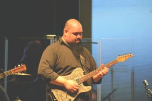 Otoniel Acevedo playing electric guitar for the UC worship team!